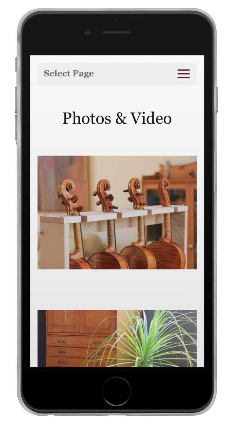 Joseph Curtin Studios website displayed on an iPhone