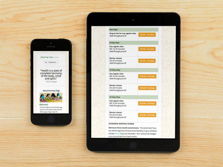 Harmony Yoga site shown on iPhone and iPad